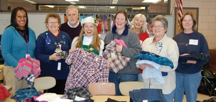 Delivering Christmas: NCSD, The Place's Holiday Clothing Drive