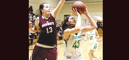 Lady Trojans slam Sidney for first round sectional win