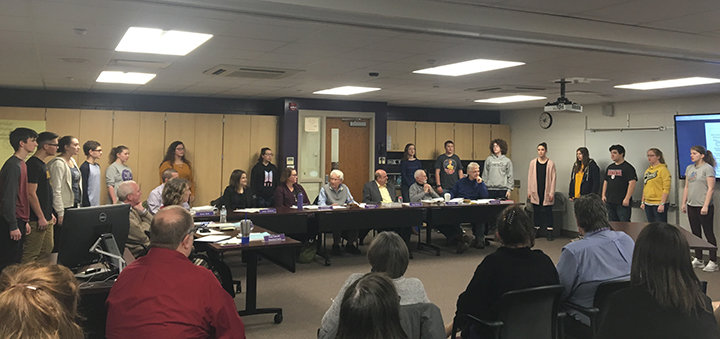 NHS Madrigal Singers perform at board meeting