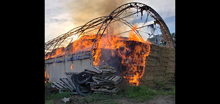 Barn continues to burn after multi-department battle with hay fire