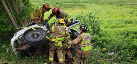 Firefighters save two trapped in crushed car