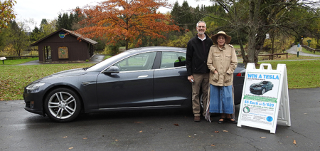 Friends of Rogers electric car raffle winner picks up their new Tesla
